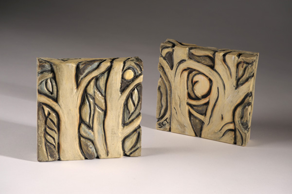 Pair of hand carved ceramic tiles by Susan Cohen Thompson